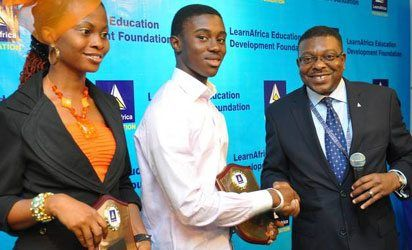 Joint winners of first position in the last NECO Examination, Miss Anazor Sandra Obianaju of the Federal Govt. Girls College, Onitsha, Anambra State and Mr.Chizoba Obasi of Stella Maris College,Abuja being congratulated by the Chairman, LearnAfrica Plc, Chief Emeka Iwerebon (right) during the LearnAfrica Excellence Award, in Lagos.