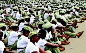 nysc members sitting in camp